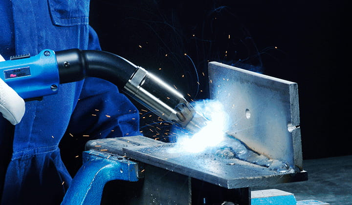 On-torch welding fume extraction solution