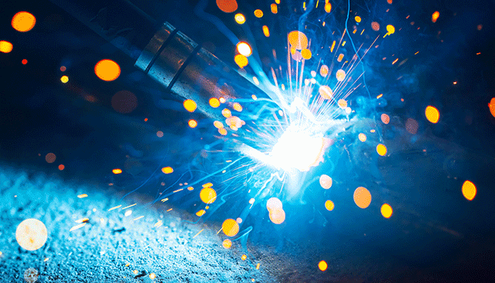 On-torch welding fume extraction
